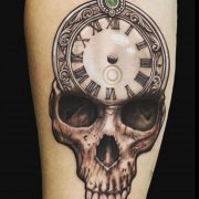 skull and time piece tattoo, clock tattoo, pocket watch tattoo