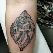 dot work tattoo, floating mountain tattoo, tattoo studio, landscape tattoo, linework tattoo,