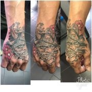hand tattoo, water demon tattoo,