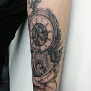 rose tattoo, pocket watch tattoo, dotwork tattoo, blackwork tattoo, realistic tattoo
